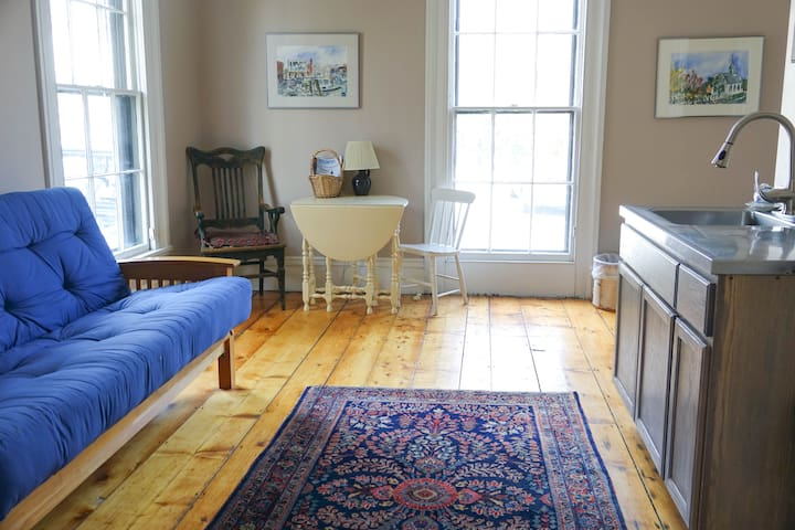 Original  pine wood floors.  Futon folds down into a queen size bed. Extra bedding available upon request