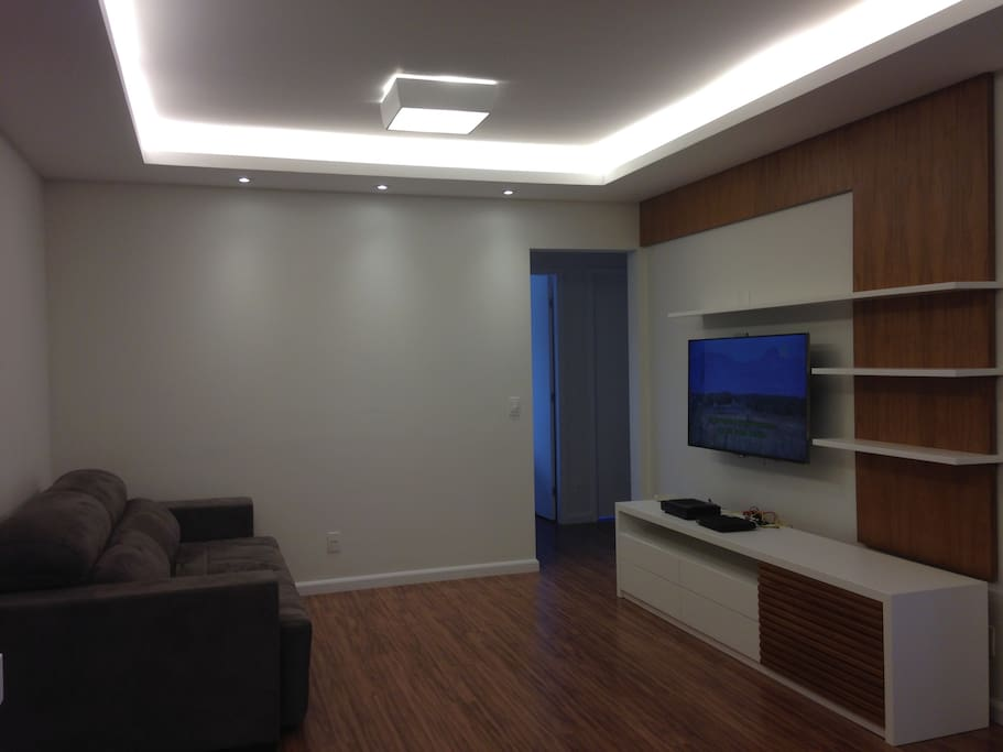 Spacious living room with TV 4K size 48´ and retractable sofa
