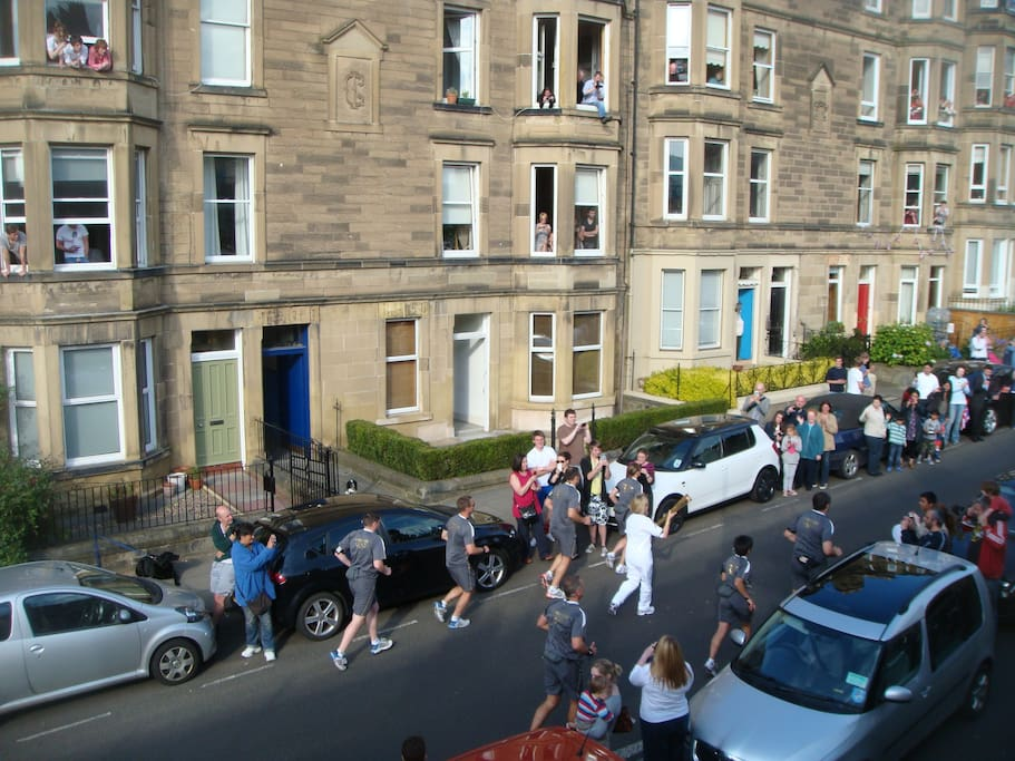 View of the Olympic Torch being carried past my house!