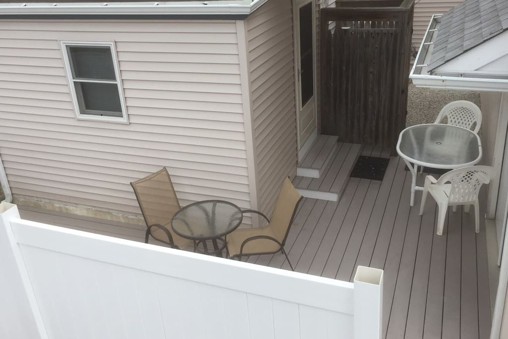 deck with patio seating and private outdoor shower