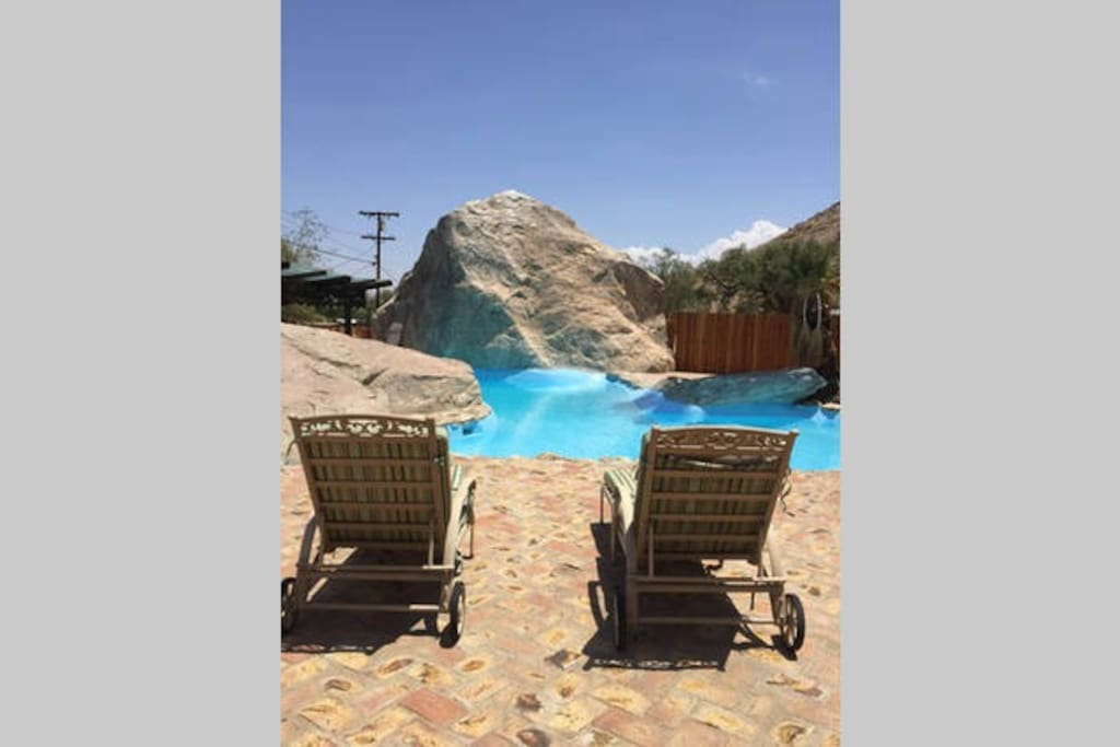 Experience the pool with beautiful natural rock formations surrounding it. It is shared with one other rental.