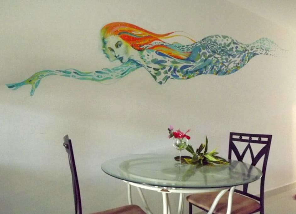 Close up of the mermaid mural flying over the dining area