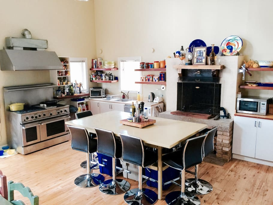 Huge kitchen with 8' island - has a fireplace for winter use