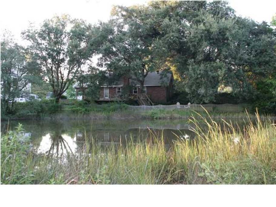House nestled amoung old oaks
