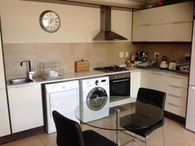 Well equipped modern kitchen including washing machine and tumble dryer.