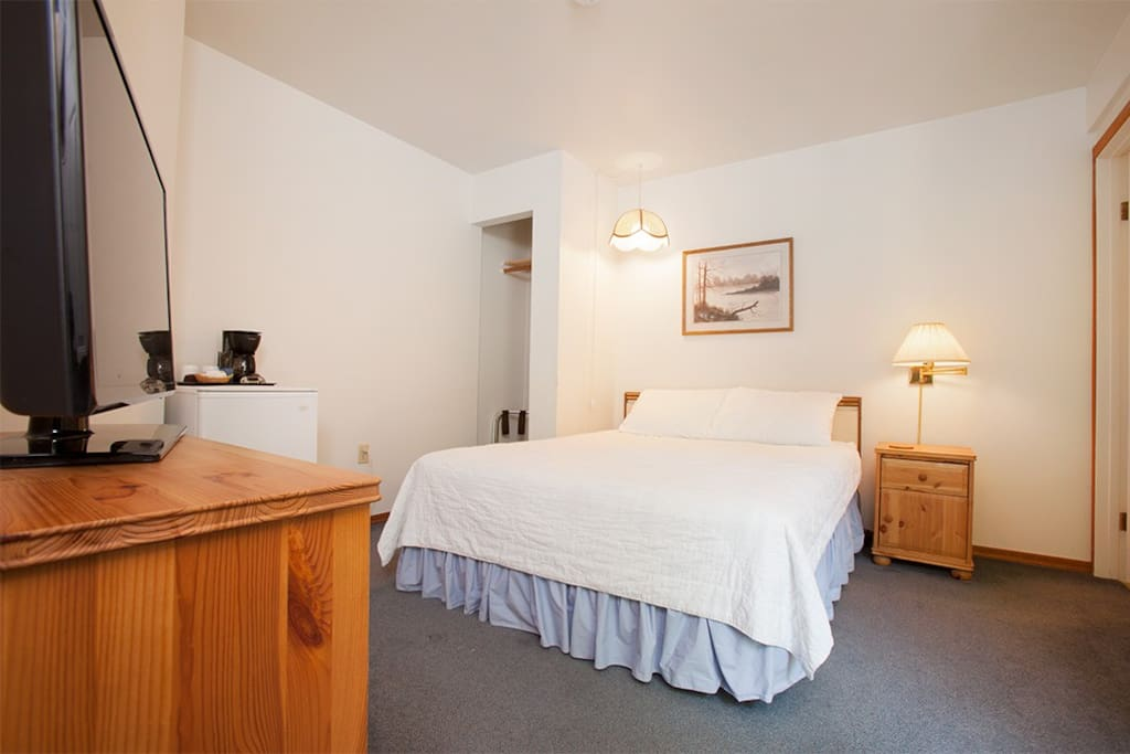 Queen Beautyrest bed, private bathroom, LED TV with Cable and Mini Fridge.