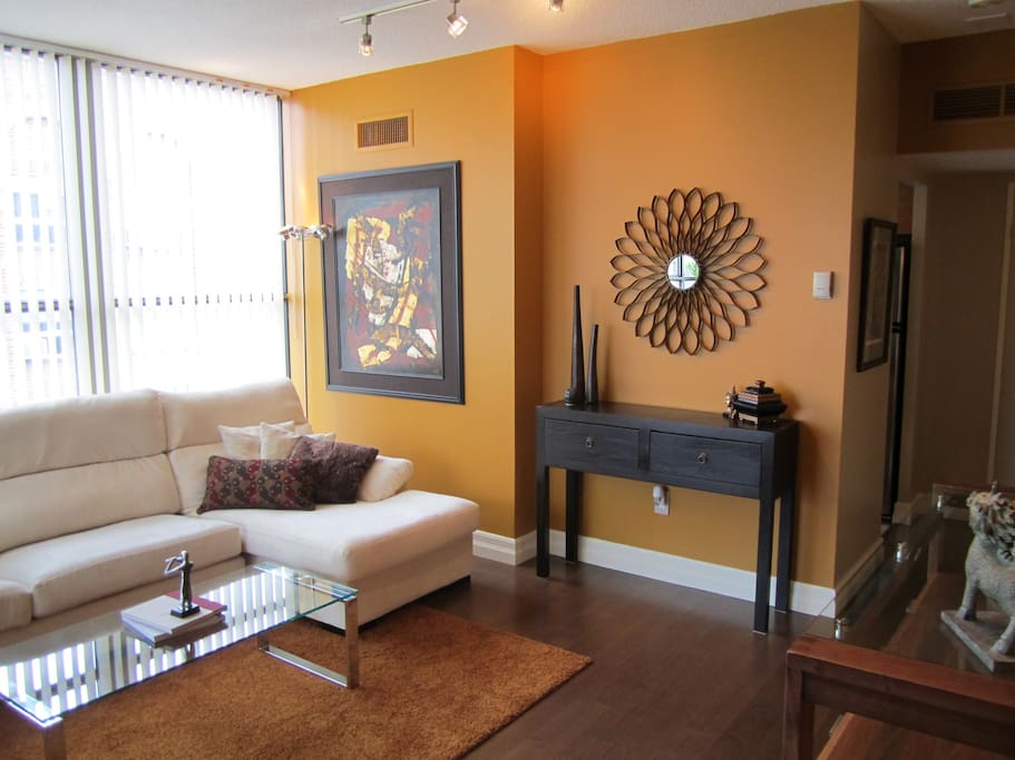Bright, spacious livingroom with modern design features. Original artwork by Canadian artists throughout.