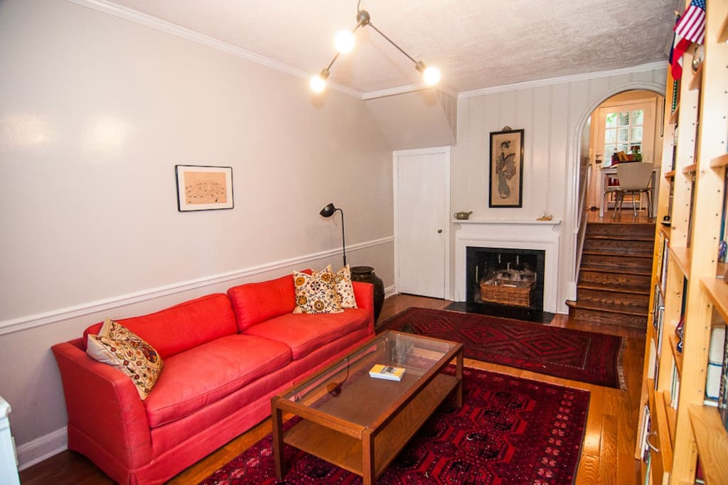 A cozy sitting room with an inactive fireplace...