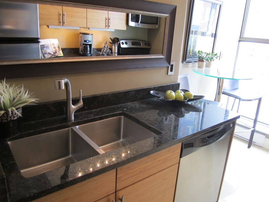Remodelled kitchen with reed bamboo cabinets, granite countertops and stainless appliances.