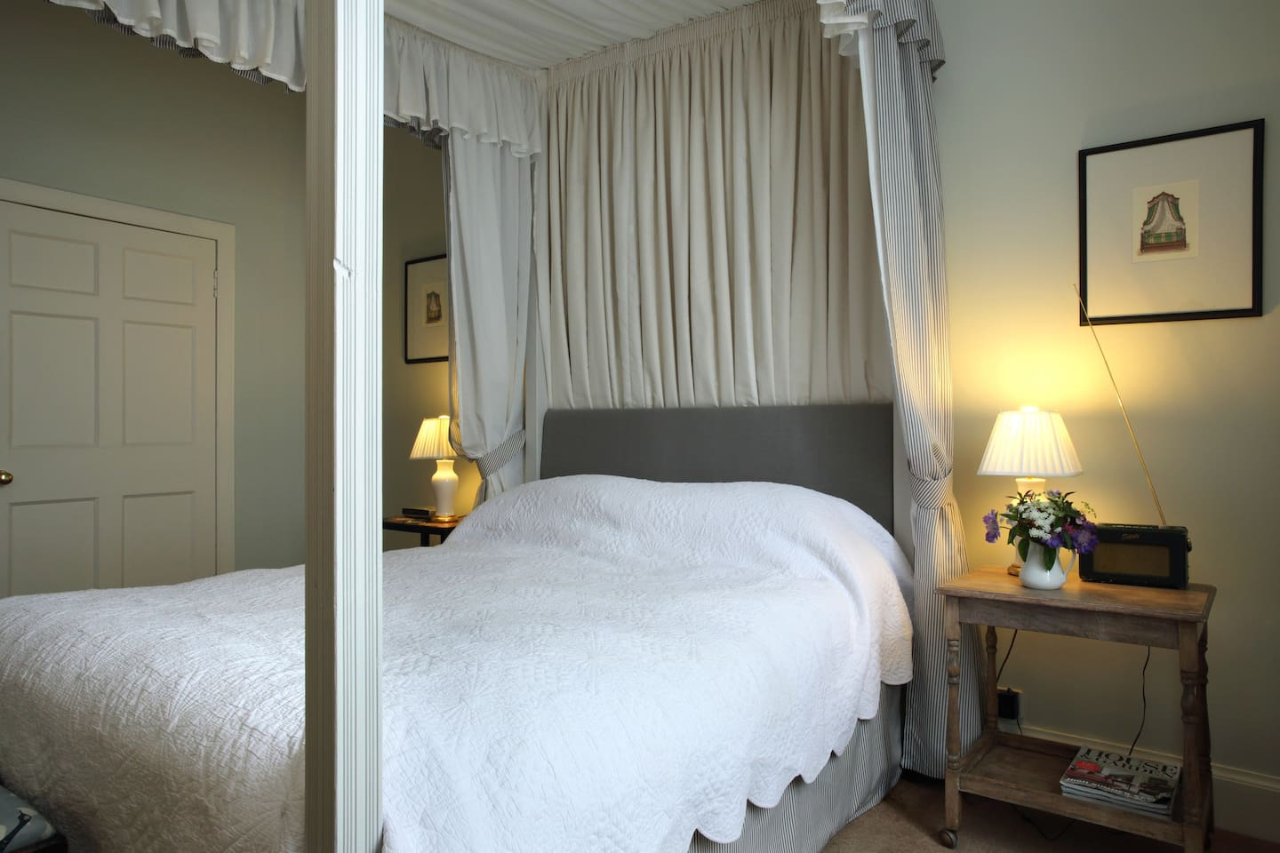 Master bedroom with an airy four poster bed and ensuite bathroom