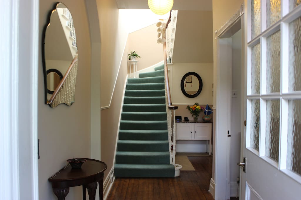 A graceful, curving staircase leads from the entrance hall to your bedroom and bathroom.