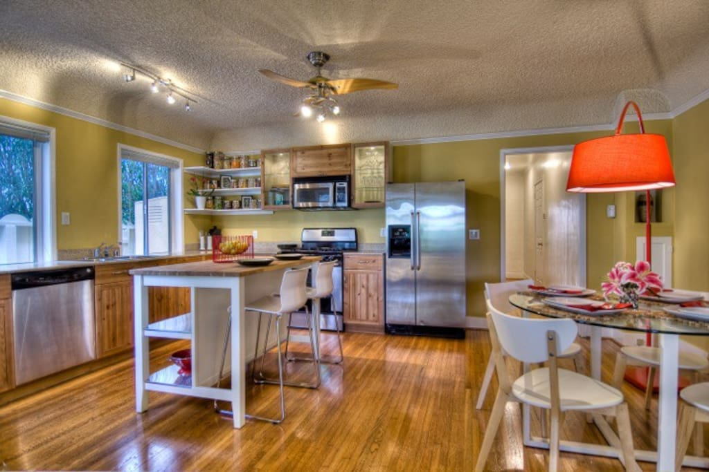 The openness of the fully stocked kitchen makes it easy to prepare a meal without losing contact with the loved ones you're here to spend time with. The stainless steel appliances are obvious, but the coffee maker is hiding in there, too.