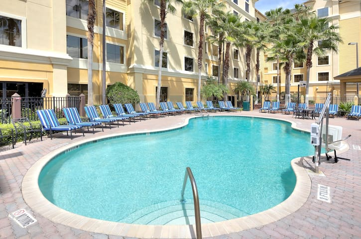 Cheerful Suite in Orlando | Keep up your fitness routine in the on-site fitness center or take a dip in the shared pool