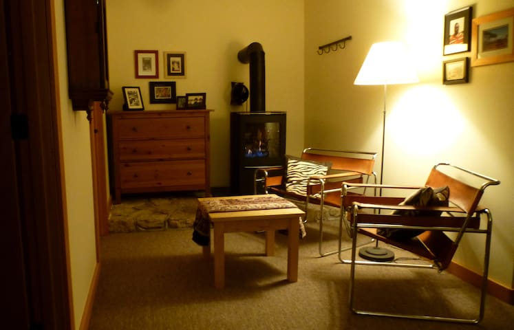 Sitting and reading room, with cozy propane stove