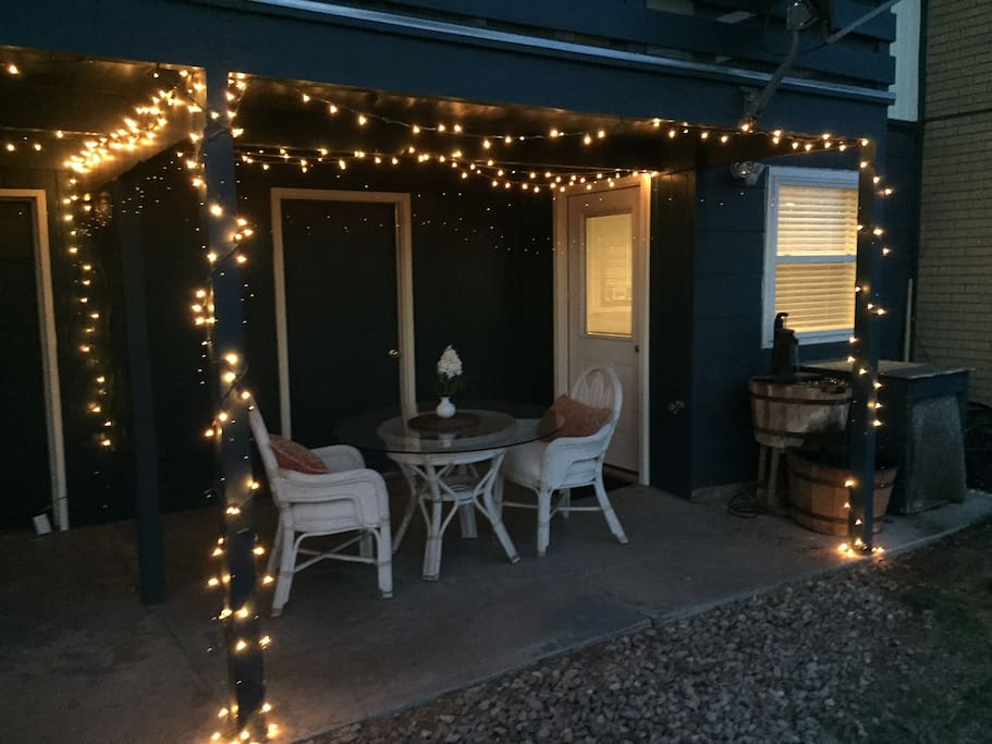 Lighted Back Patio with seating and waterfall