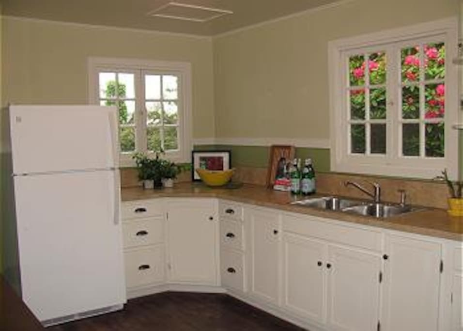 The kitchen is filled with light and views of beautiful foliage.