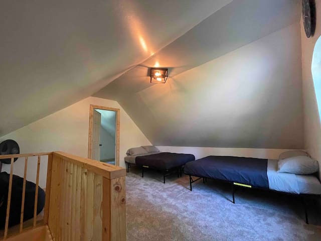 Located upstairs in the loft area outside the master bedroom. This space doesn't have its own door, but it's very spacious and has a beautiful view outside the window.
