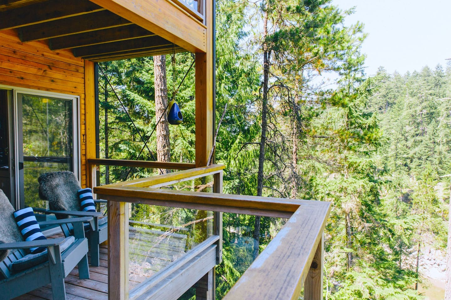 Treehouse Suite covered deck looking down to water