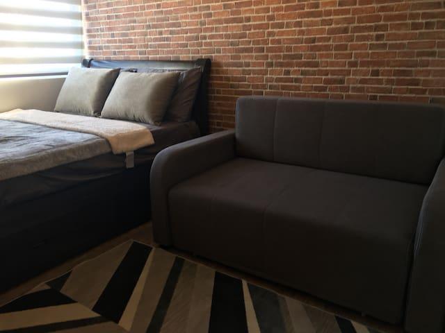 Relaxing Modern Unit in NUVALI W/ WIFI & NETFLIX