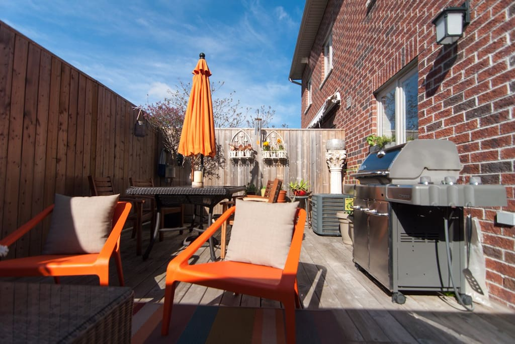 Spacious south facing back deck with Webber BBQ and dining area.
