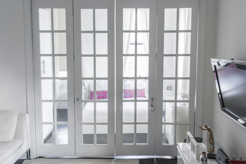 Beautiful and practical French doors give privacy and charm