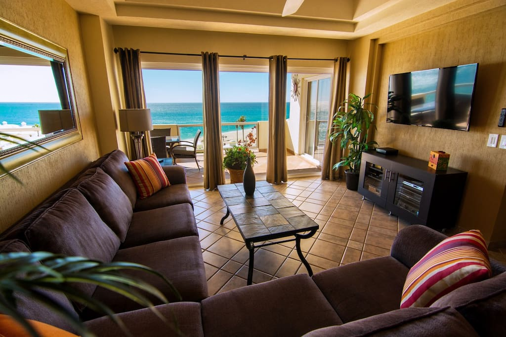 """Living area features an oversized and very comfortable """"L"""" shaped couch, room darkening curtains, queen sofa sleeper, a brand new """"50"""" Samsung smart T.V., DVD player and stereo receiver. All this and a perfect view!"""