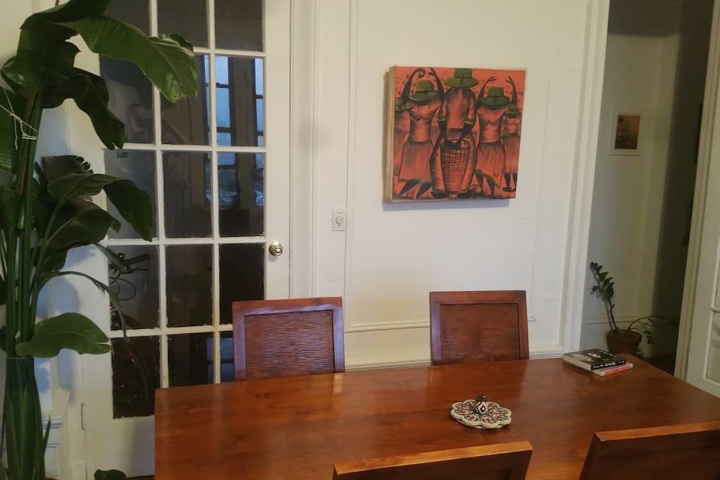 Beautiful teak dining table seats 6.