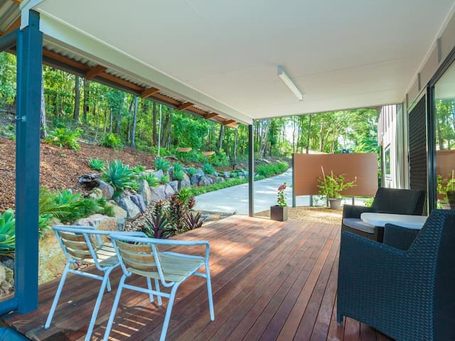 Secluded front deck looking out over forest