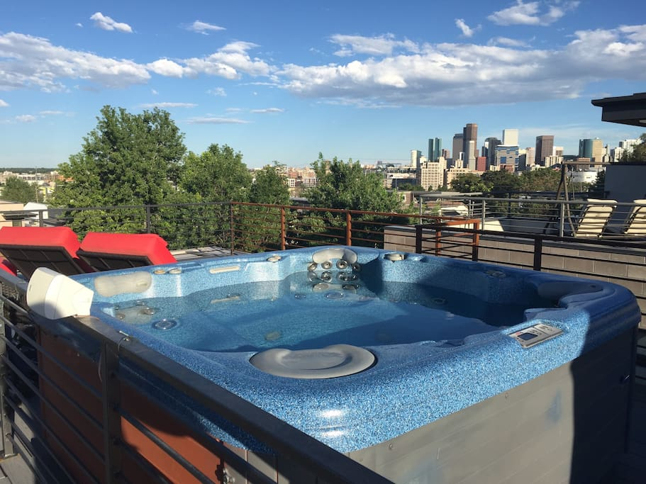 Hot Tub on the Rooftop Deck with Two Lounge Chairs