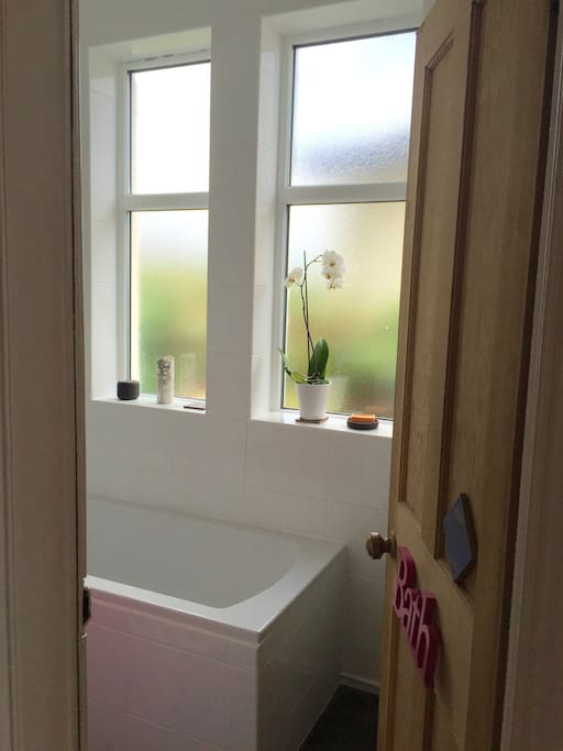 Newly fitted modern bathroom with shower and bath