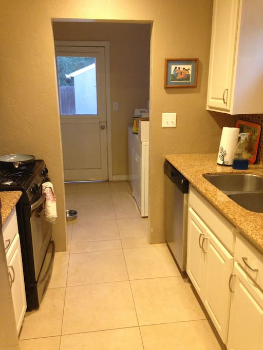 Kitchen with microwave, dishwasher, washer and dryer