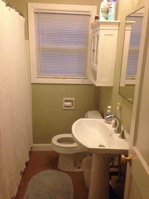 Bathroom has tub and shower