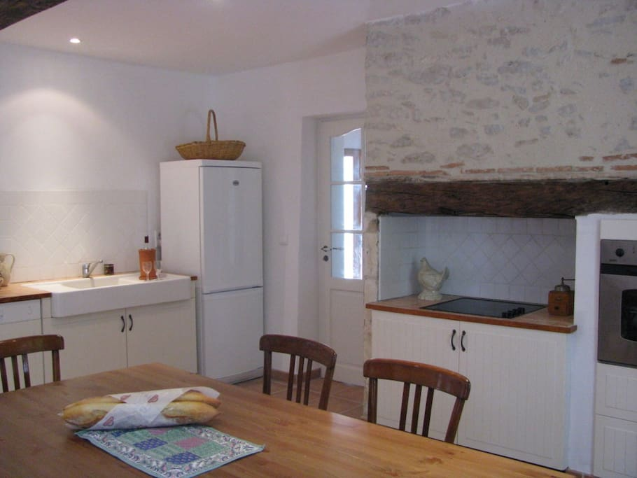 The kitchen has been decked out with modern appliances still in keeping with the style of the house