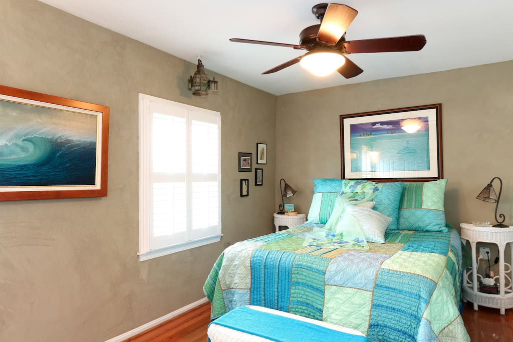 Let the ceiling fan remind you of ocean breezes!  And the shutters close tight for a dark room, Better for a good night's rest.