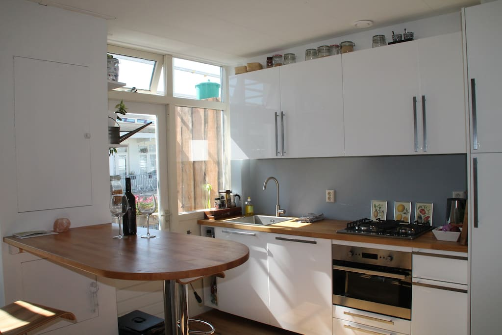 spacious kitchen with bar & all facilities