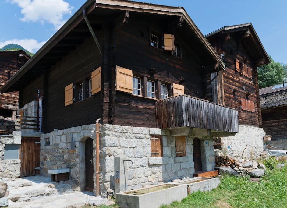 the chalet, in front a well with drinkable water