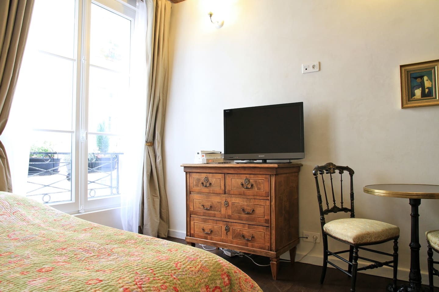 In the wardrobe, you will find Paris maps and guides, instructions about how to use the appliances, Restaurants informations, the airdryer