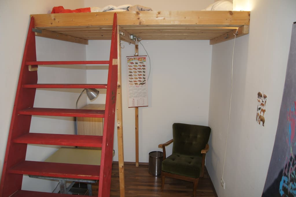 Your bedroom with queen size loft bed. There is no window to the outside, only to the corridor.