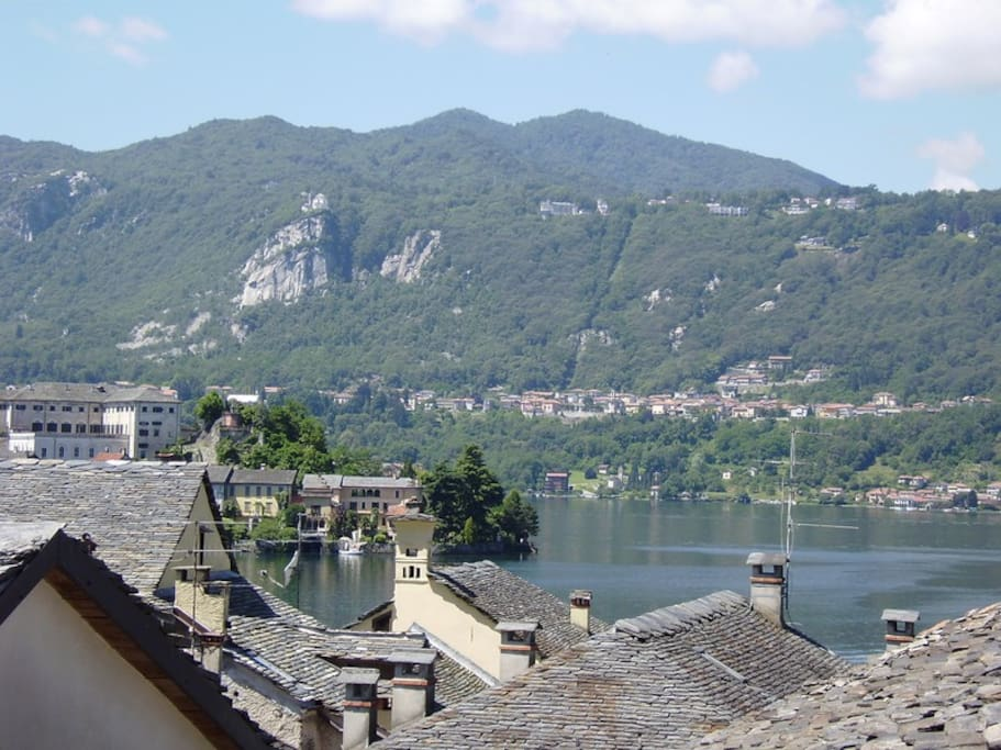 Lake view with the island over the stone roofs