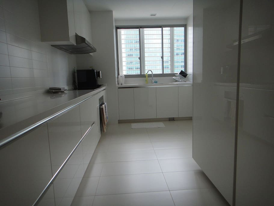 Big kitchen with washer cum dryer and fridge and a spare bathrm in the kitchen