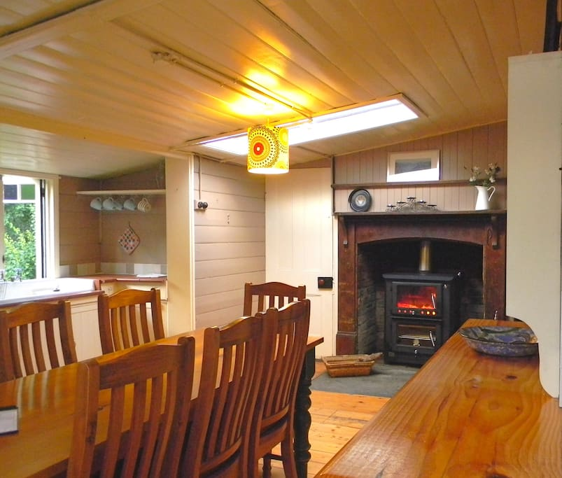 Cosy kitchen with a wood fired heater and oven
