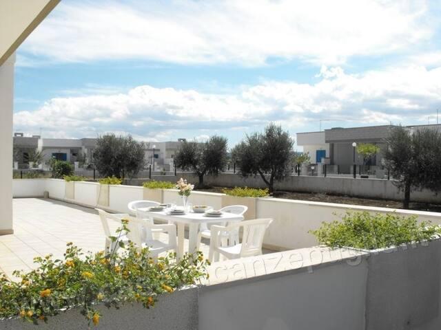 Veranda attrezzata di Villetta Monica n. 34