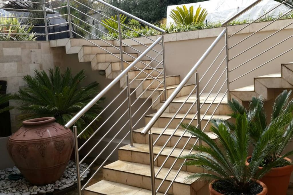 Stairs to private studio from main garden to private patio.