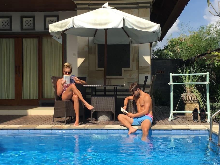 Relaxing time by the pool. These are honeymooners Margot and Mathieu, guests in June 2017, reading books from our library.