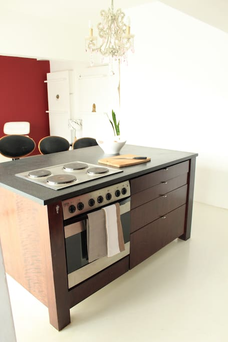 A fully equipped kitchen and kitchen island