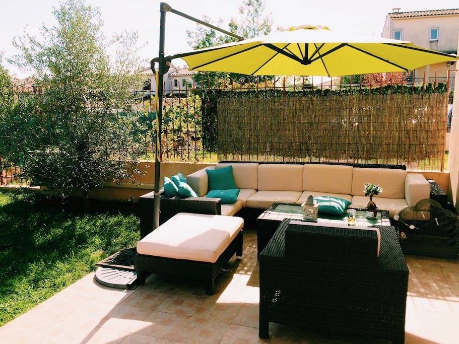 nice terrace with a lounge zone dining table and a  garden
