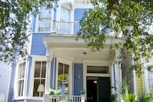 The main entrance welcomes you with a fully furnished front porch for outdoor relaxation.