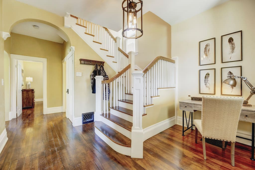Gorgeous grand staircase and hardwood floors