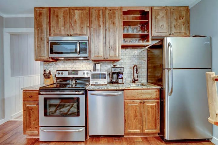 State of the art kitchenette with full size stainless appliances