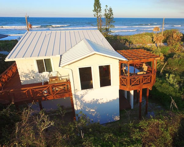 View showing back of the home, the wrap-around deck, and ocean view!